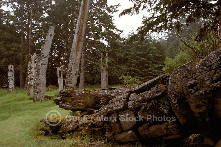 Haida Gwaii (Queen Charlotte Islands), Northern BC, British Columbia, Canada - Historic Haida Mortuary Totem Poles at Ninstints (UNESCO World Heritage Site) on Anthony Island (Skung Gwaii), Gwaii Haanas National Park Reserve and Haida Heritage Site