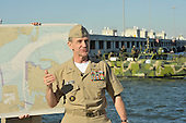 Rear Admiral Philip H. Cullum, director of the Energy and Environmental Readiness Division, briefs civic and military leaders before a demonstration Friday, October 22, 2010 of the Riverine Command Boat (Experimental) (RCB-X). The RCB-X is powered by an alternative fuel blend of 50 percent algae-based and 50 percent NATO F-76 fuels to support the Secretary of the Navy's efforts to reduce total energy consumption on naval ships. .Mandatory Credit: Gregory N. Juday - U.S. Navy via CNP.