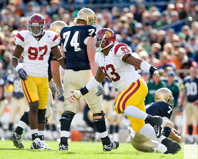 10/17/09 - South Bend, IN:  USC defensive end Everson Griffen celebrates sacking Notre Dame quarterback Jimmy Clausen at Notre Dame Stadium on Saturday.  USC won the game 34-27 to extend its win streak over Notre Dame to 8 games.  Photo by Christopher McGuire.