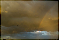 Rainbow and plane flying through stormy skies on the periferico & segundo piso in mexico city, Saturdat 14, 2007