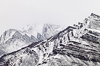 Fresh snow on the Brooks range mountains reveal geological folds in the rock, Atigun canyon, Arctic, Alaska