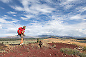 ID00244-00...IDAHO - Vicky Spring hiking the wilderness trail in Craters Of The Moon National Monument. (MR# S1)