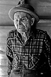 """December 1971:  Modesto, California—Dad Walkling—Dad recites his favorite poem about an elberta peach.  I first met Orlando """"Dad"""" Walkling at his house in the airport district of Modesto just before his 104th birthday.  Walkling was born in Indian Territory January 2, 1868, near a town now called McAlester, Oklahoma.  His mother was Shawnee and his father, whom he didn't remember, was an Englishman named Orlando.  He later used the name Walkling instead of his Indian name of Skipocase.  On September 16, 1893, Skipocase O. Walkling, then 25 years old, was among thousands of settlers who rode into the Cherokee Strip Land Run of Oklahoma to make a free land claim.  Walkling told of how he rode into the 226-mile long """"Strip"""" to claim 160 acres.  """"There were thousands of men who waited at the line until noon that day.  The army gun was fired and chaos broke out. Every man carried a gun. There was no law, no sheriff, nothing.  People had to fight for their claim even though they were first.""""  Walkling made a claim, but later gave it up when he had a chance to farm a piece of land in Noble County, Oklahoma.  He cleared the land with six yoke of oxen and planted peach orchards.  He and his first wife ran a combination grocery store and hotel there.  He had nearly 1,000 trees and began a cannery to process the crops.  """"One day when the train came in a woman dressed like a Salvation Army woman handed me a bundle as I stood on the ramp, then she jumped back into the train.  I opened it and there was a pair of twins, a boy and a girl,"""" Walkling said.  He and his wife did not have children, so they adopted the twins legally and raised them.  He said they raised six others but did not adopt them.  He came to Modesto in 1944 at 76 years of age and went to work for a meat firm before he opened a poultry store.  After that store closed, he made bullwhips and wove rope for truckers at his home.  In 1968, Dad Walking, then 100 years old, visited Oklahoma for the 75th anniver"""