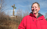 WATERBURY, CT. 08 January 2008-010408SV02--Cliff Lennox, engineer in charge of rebuilding the cross at Holy Land hikes up to the base of the cross in Waterbury Friday. The Holy Land Cross will be dismantled and rebuilt with new lighting.<br /> Steven Valenti Republican-American