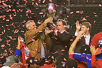 FC Dallas headcoach Schella Hyndman (left) and owner Clark Hunt (right) hoist the MLS Western Conference Championship trophy. FC Dallas defeated the LA Galaxy 3-0 to win the Western Division 2010 MLS Championship at Home Depot Center stadium in Carson, California on Sunday November 14, 2010.