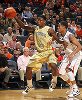 Jan. 22, 2011; Charlottesville, VA, USA; Georgia Tech Yellow Jackets guard Iman Shumpert (1) handles the ball in front of Virginia Cavaliers guard Mustapha Farrakhan (2) during the game at the John Paul Jones Arena. Mandatory Credit: Andrew Shurtleff-US PRESSWIRE