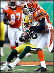 Donald Driver is tackled by Cincinnati's Tory James after a 28-yard gain in the 3rd quarter. .The Green Bay Packers traveled to Paul Brown Stadium to play the Cincinnati Bengals Sunday October 30, 2005. Steve Apps-State Journal.