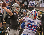 Oakland Raiders quarterback Derek Carr (4) passes under pressure on Sunday, December 04, 2016, at O.co Coliseum in Oakland, California.  The Raiders defeated the Bills 38-24.