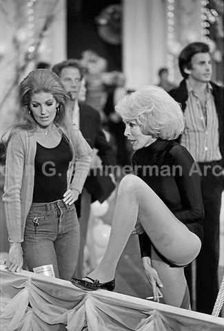 """Actress Janet Leigh (R) stretches backstage at the """"Circus of the Stars,"""" (CBS Special), Santa Monica Civic Auditorium, November, 1976. Photo by John G. Zimmerman"""