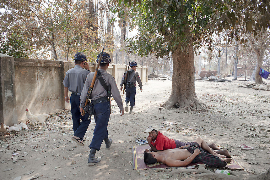 Police patrol Kyawe Pone Lay in Oakkan Township. The Muslim village was attacked by a mob, some of which they knew by name, in the early evening on April 30. Following the attack, 100 of the 500 residents have fled to Yangon.
