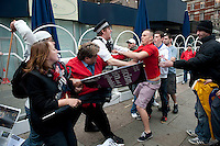 Anti racist and Muslim groups are attacked outside the French embassy in Knightsbridge by members of the far right English Defence League. The protest was over the banning of Muslim veils by the French government.