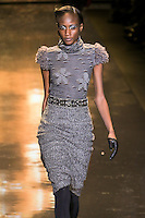 Aminata Niaria walks runway in an outfit from the Badgley Mischka Fall 2011 fashion show, during Mercedes-Benz Fashion Week Fall 2011.