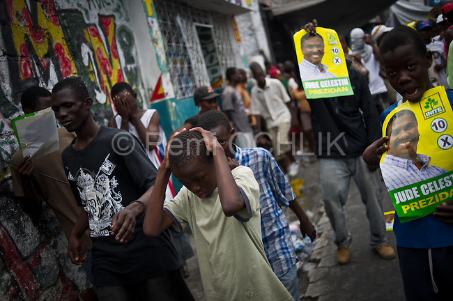 """© Remi OCHLIK/IP3 - Port au Prince on 2010 december 9 - PORT-AU-PRINCE -- Clashes and shooting were reported Thursday in Haiti's capital for a second day as demonstrators staged a march to protest what they said was election fraud in the Nov. 28 presidential elections..The protests broke out Wednesday after election officials announced Tuesday night that two candidates had made it into a runoff: Mirlande Manigat, a former first lady, and Jude CÈlestin, the candidate of current President RenÈ PrÈval's party. Out of the running was Michel """"Sweet Micky'' Martelly, who early results had shown running second. -  Celestin supporters demonstrate in Bel Air district."""