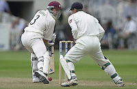 Photo Peter Spurrier.31/08/2002.Cheltenham & Gloucester Trophy Final - Lords.Somerset C.C vs YorkshireC.C..Somerset batting Michael Burns watches as the ball passes the wicket after playing the ball. Wicketkeeper Richard Balkey look's on