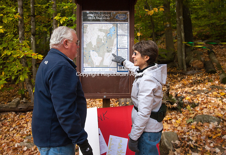 TORRINGTON, CT - 24 OCTOBER 2015 - 102415JW02.jpg -- Matt Boylan of New Hartford and Frances Moulder of Torrington look over the map at the trail head of Buttrick Trail Saturday morning before the start of the ribbon cutting ceremony by the Torrington Trails Network dedicating the trail to Judith Bekaski who was one of the founding members of the network. The trail connects the Sue Grossman Still River Greenway to both Burr Pond and Sunnybrook State Parks. Jonathan Wilcox Republican-American