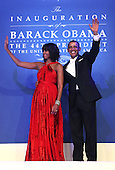 United States President Barack Obama and first lady Michelle Obama waves to supporters during the Inaugural Ball January 21, 2013 at Walter E. Washington Convention Center in Washington, DC. Barack Obama was re-elected for a second term as President of the United States.  .Credit: Alex Wong / Pool via CNP