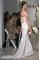 "Model walks runway in a Bridal gown from the Anne Bowen Bridal Spring 2013 ""Coat of Arms"" collection fashion show, during Bridal Fashion Week New York April 2012."