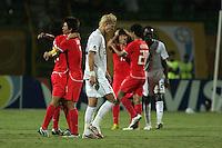 The United States' Brek Shea (20) walks past celebrating South Korean players at the end of the FIFA Under 20 World Cup Group C match between the United States and South Korea at the Mubarak Stadium on October 02, 2009 in Suez, Egypt. The US team lost 3-0.