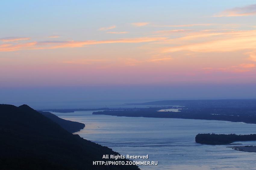 Sunset skies over Volga river and Zhiguli dam power station