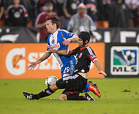 Daniel Woolard (21) of D.C. United tackles the ball away from Antoine Hoppenot (29) of the Philadelphia Union during a Major League Soccer game at RFK Stadium in Washington, DC. D.C. United tied the Philadelphia Union, 1-1.