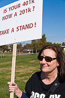 """Beverley holds a """"Is your 401K now a 201k?  Take a stand!"""" sign during the Occupy Orange County, Irvine march on November 5."""