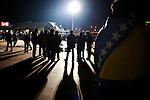 Fans of the Bosnian national handball team rally at the national stadium at Skenderija in Sarajevo before a EURO2010 match between Bosnia and Serbia. Bosnia won the match 31:28. Police attend to the crowd.