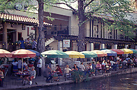 People eating in an outdoor restaurant on the River Walk in San Antonio, Texas