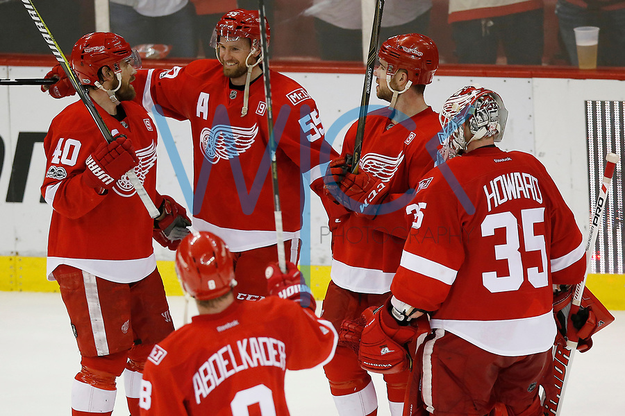 Henrik Zetterberg #40 is congratulated by teammates following their 3-1 win against the New Jersey Devils at Joe Louis Arena in Detroit, Michigan on Sunday April 9, 2017. (Photo by Jared Wickerham/The Players Tribune)