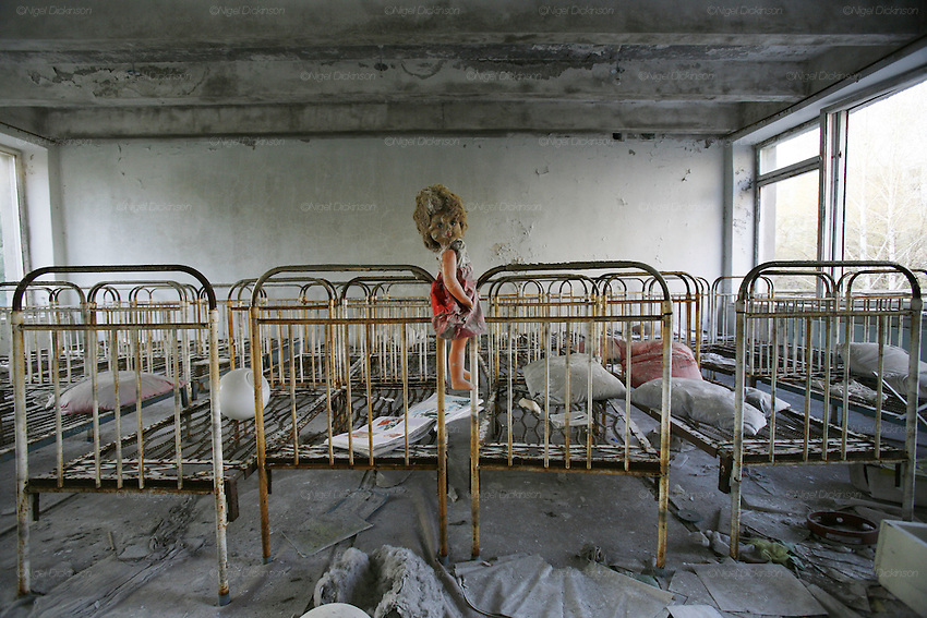 Chernobyl, Exclusion Zone, Ukraine. Beds  in the children's ward of the Maternity Hospital  with reflection of sunset over town. Pripyat Town built 15 years before the Chernobyl reactor fire. The whole town was evacuated shortly after. The  Chernobyl Reactor, towns, plant and environs just before the 20th anniversary of the nuclear disaster.