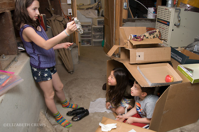 Berkeley CA Girl, 9, putting on show for brother, 7  and Chinese friend, 9 in theater she's created out of old boxes  MR