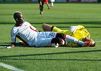 23 June 2011: New England Revolution forward Saer Sene #39 battles with Toronto FC goalkeeper Milos Kocic #30 during an MLS game between the New England Revolution and the Toronto FC at BMO Field in Toronto..The game ended in a 2-2 draw.