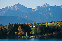 Small dock on Forggensee and Allgaeu alps in distance, Bavaria, Germany