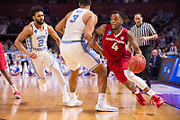 NWA Democrat-Gazette/J.T. WAMPLER Arkansas' Daryl Macon drives around North Carolina's Kennedy Meeks Sunday March 19, 2017 during the second round of the NCAA Tournament at the Bon Secours Wellness Arena in Greenville, South Carolina.