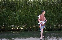 Louis waiting to be picked up by Obie. Gibson beach. Bridgehampton, New York, USA