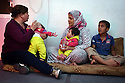 TRAUMA HEALING CASE STUDIES. MARGARET KHABBAZ, TRAUMA HEALING FACILITATOR FOR BIBLE SOCIETY SITS WITH SARAA AREF, 30 AND THREE OF HER SIX CHILDREN, IRBID, JORDAN. 20/4/16. PHOTO BY CLARE KENDALL.