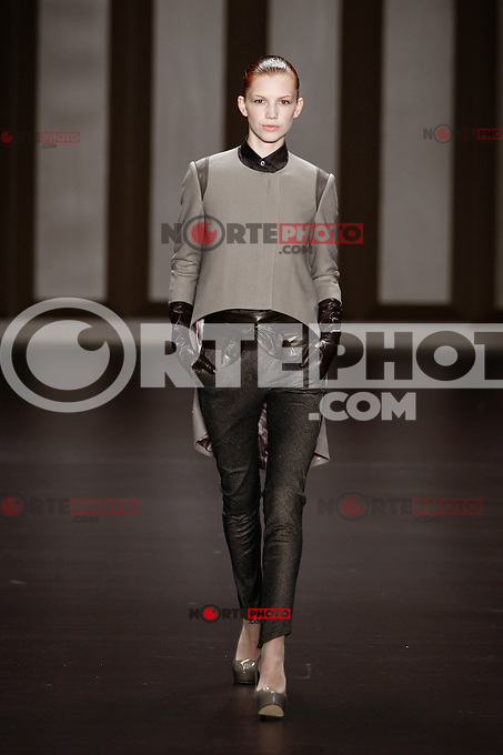 A model walks the runway at the BEAUTYBERRY BY WANG YUTAO PRESENTED BY MERCEDES-BENZ AND ELLE FASHION SHOW during the Mercedes-Benz Fashion Week autumn/winter 2012 Berlin at Brandenburger Gate in Berlin, Germany, 20.01.2012...Credit: Poslada/face to face /MediaPunch Inc.