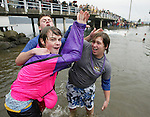 Ryan Schurmacher, left, Joe Weger, center, and Sam Daheim, right, of Tacoma, Washingtion, celebrate after jumping off the bridge during the 23rd annual Olalla polar bear jump into the Burley lagoon in Olallar, Washington on January 1, 2007. Jim Bryant Photo. ©2010. ALL RIGHTS RESERVED.
