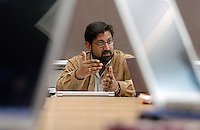 Dhavan Shah, professor of journalism and mass communications and political science, seen framed by two laptop computers, leads a meeting of graduate students and faculty affiliated with the Mass Communication Research Center as they discuss research design for their next study investigating relationships between media, including the internet, and public opinion.<br /> <br /> Client: University of Wisconsin-Madison<br /> &copy; UW-Madison University Communications 608-262-0067<br /> Photo by: Michael Forster Rothbart<br /> Date:  12/05    File#:  D100 digital camera frame 19150.