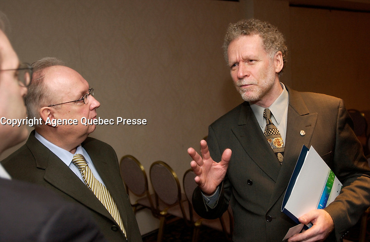 February 26, 2002, Montreal, Quebec, Canada; <br /> <br /> Quebec new Minister in charge of Tobacco; Roger Bertrand (R) discusss with 2 unidentified men, shortly after beeing nominated, February 26th 2002, in Montreal, Canada<br /> <br /> The Quebec Government  maintain  high taxes on cigarettes and tobacco product and introduce many programs to help people quit smoking.