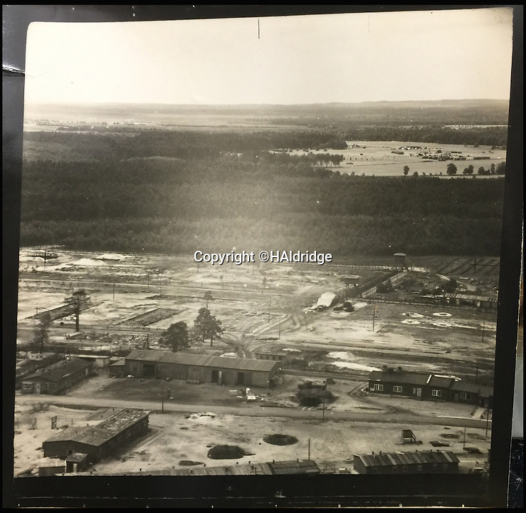 BNPS.co.uk (01202 558833)<br /> Pic: HAldridge/BNPS<br /> <br /> An aerial image of Belsen taken by the Spitfire pilot.<br /> <br /> A Spitfire pilot's own snaps of some of the Nazi's most notorious murderers after they were detained for their horrific war crimes have been found in an old suitcase.<br /> <br /> RAF Officer Keith Parfitt took his own photos of the monsters, who included Franz Hossler, a commander at Aushwitz concentration camp and then deputy commandant of Burgen-Belsen, and Irma Grese, the so-called 'Bitch of Belsen'.<br /> <br /> The pictures have been discovered in an old case by relatives and are now being sold by Henry Aldridge and Son of Devizes, Wilts.