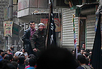 On March 15, dozens of residents from the Bustan Al-Qasr neighborhood of Aleppo participate on a Friday protest to mark the two-year anniversary of the Syrian revolution. Protests are kept small in number and are organized in several neighborhoods of the city. The rationale is that a larger, massive protest is more likely to come under mortar or aircraft attacks (as they have in the past). Two years into the conflict, fractures and fissures between the Free Syria Army umbrella are starting to become apparent. Along the same lines, civilians are also beginning to complain openly (as they did through chants in this particular protest) about certain groups of fighters amongst the larger Free Syria Army coalition. On this day, a commander of a local Free Syria Army group was accused of corruption - it ended with a fist fight and a speech by this commander - the protest was dissolved and the crowd dispersed.