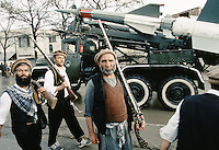 Mudjahedins with gun from the war again the British force a century a go, passing next to a Russian Newa anti-aircraft missile type S-125 in the capital Kabul.