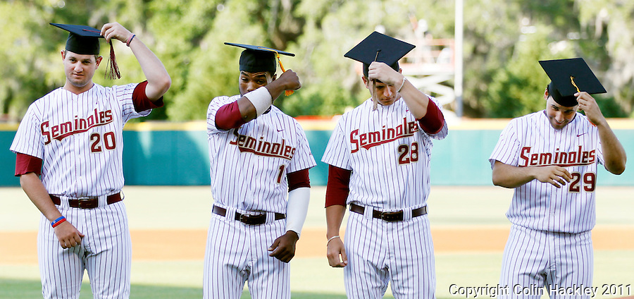 TALLAHASSEE, FL 5/7/11-FSU-UCFBASE11 CH-Graduates on the 2011 Florida State baseball team Daniel Bennett, left, Taiwan Easterling, Tyler Everett, Rafael Lopez, turn their tassels during a ceremony honoring them prior to the University of Central Florida game Saturday at Dick Howser Stadium in Tallahassee. The Seminoles lost to the Knights 10-14..COLIN HACKLEY PHOTO