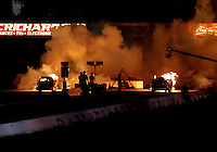 Jun 10, 2016; Englishtown, NJ, USA; NHRA jet funny car driver Rich Hanna (left) races alongside Ken Hall during qualifying for the Summernationals at Old Bridge Township Raceway Park. Mandatory Credit: Mark J. Rebilas-USA TODAY Sports