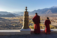 Buddhist monks look over the Indus River Valley from Thiksey Monastery in the Ladakh region of India.