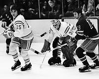 California Golden Seals vs New York Rangers 1974.<br /> Jim Neilson, Ranger Jean Ratelle, and Seals goalie Gary Simmons &quot;the Cobra&quot;(photo/Ron Riesterer)