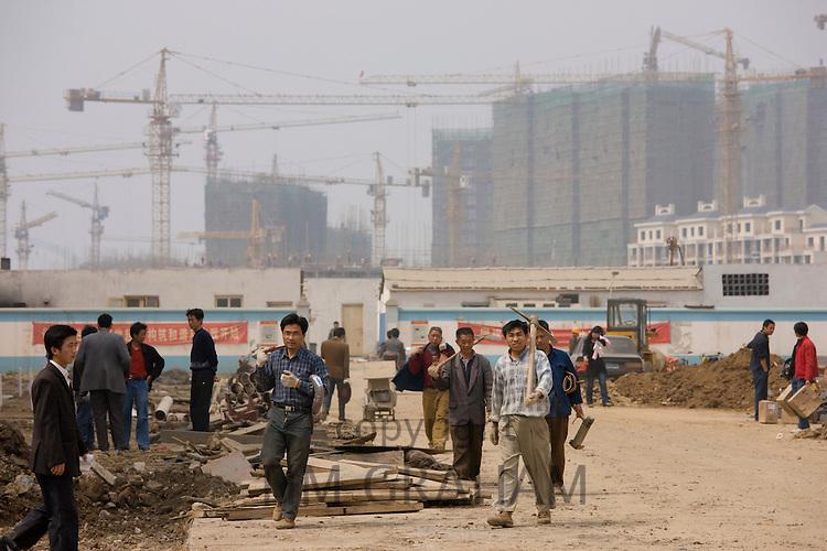 Workmen on a housing development in Yichang, China