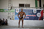 A Palestinian contestant takes part in a local bodybuilding championship in Gaza City October 30, 2015. Photo by Mohammed Talatene