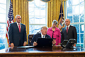 U.S. President Donald J. Trump (C-L) reads one of three executive actions that he said are 'designed to restore safety in America' while Vice President Mike Pence (L), Attorney General Jeff Sessions (R) and his wife, Mary Blackshear Sessions (C-R) look on in the Oval Office of the White House in Washington, DC, USA, 09 February 2017. On 08 February, after a contentious battle on party lines, the Senate voted to confirm Sessions as attorney general.<br /> Credit: Jim LoScalzo / Pool via CNP