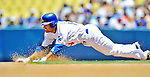 24 July 2011: Los Angeles Dodgers infielder Jamey Carroll steals second base during a game against the Washington Nationals at Dodger Stadium in Los Angeles, California. The Dodgers defeated the Nationals 3-1 to take the rubber match of their three game series. Mandatory Credit: Ed Wolfstein Photo